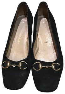 Gucci black and gold. Pumps