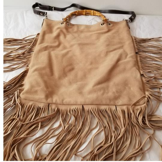 Preload https://img-static.tradesy.com/item/23279314/rossellad-with-fringes-suede-leather-tote-0-1-540-540.jpg