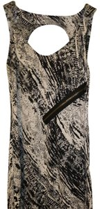 Guess short dress Ivory and black print with gold zipper detail on left side of dress. on Tradesy