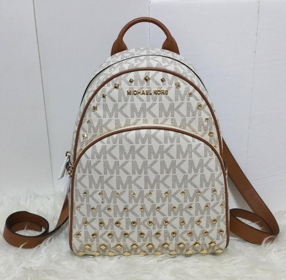 f853b0ade46bff Michael Kors Mk Abbey Medium Studded White Coated Canvas Backpack ...