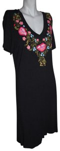Caite short dress Black Embroidered Flowers Stretchy on Tradesy