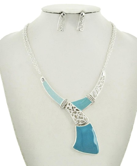 Preload https://img-static.tradesy.com/item/23295482/silverblue-ltblue-acrylic-y-neck-and-earring-set-necklace-0-1-540-540.jpg