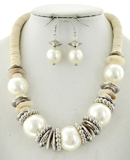 Preload https://img-static.tradesy.com/item/23295573/white-wood-cream-synthetic-pearl-earring-set-necklace-0-1-540-540.jpg