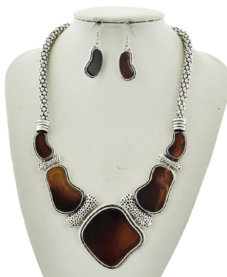 Preload https://img-static.tradesy.com/item/23295615/brown-acrylic-epoxy-statement-and-earring-set-necklace-0-1-540-540.jpg