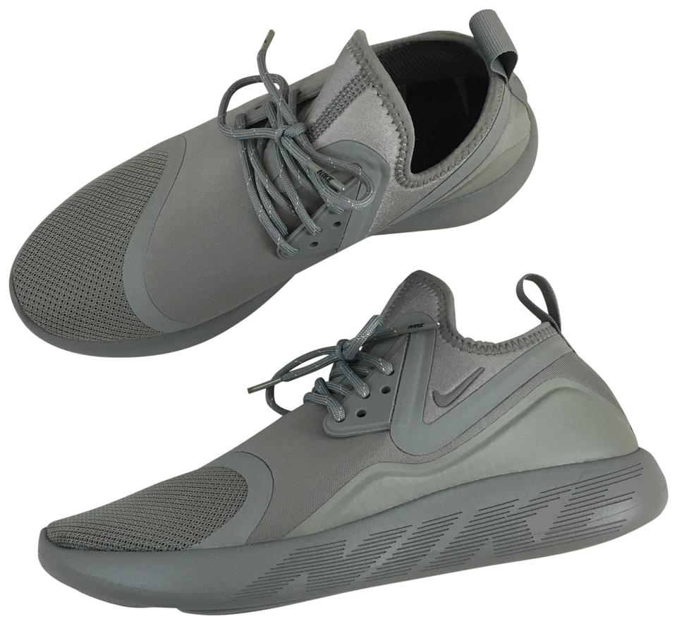 6af6557f3b Nike Women s Lunarcharge Essential Olive Sneakers Features A Comfortable  Neoprene Boot Construction. Style Color  Sneakers. Size  US 9 Narrow (AA ...