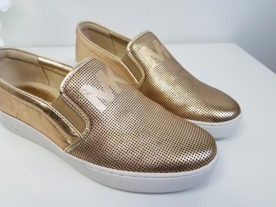 MICHAEL Michael Kors Perforated Leather Gold Flats Image 1