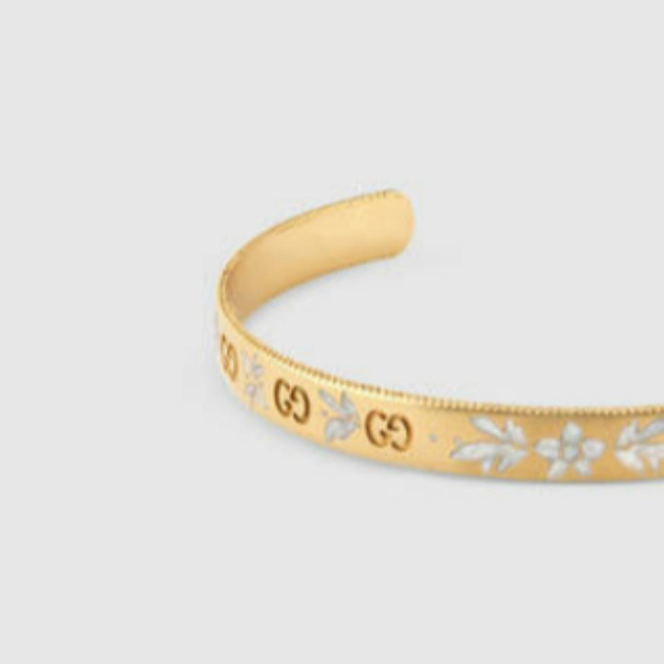 4088dcdbaaa9c Gucci Icon In 18k Yellow Gold with Interlocking G Motifs and White Enamel  Engraved Blossom Design Bracelet 41% off retail