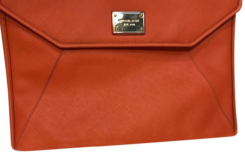 3ecb57d13096b Michael Kors Michael Kors Saviano orange leather laptop sleeve Image 0 ...