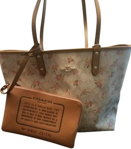 Coach Leather Reversible Monogram Tote in Tan/Floral