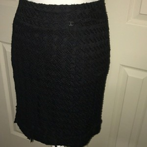 Chanel Skirt Black lacey Chanel skirt size 38 European which is a size 8 US. Beautiful fine mesh/lace pattern with bows at the hemline. CC logo at the waist. Pictures do not do it justice.