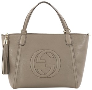 44ce7067ac25 Added to Shopping Bag. Gucci Leather Tote in taupe. Gucci Soho Convertible  Top Handle ...