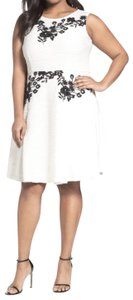 Taylor short dress White Super Femme Flattering Cut Floral Embroidery Flared Silhouette Hidded Back Zip on Tradesy