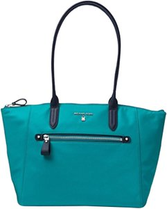e75bd76e5a0a3 Added to Shopping Bag. MICHAEL Michael Kors Tote in Tile Blue Admiral. MICHAEL  Michael Kors Kelsey Medium Top-zip ...