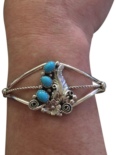 Preload https://img-static.tradesy.com/item/23330364/navajo-and-turquoise-sterling-silver-cuff-bracelet-0-1-540-540.jpg