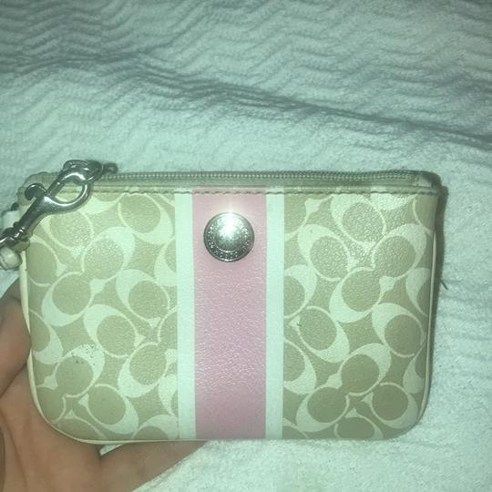 Coach Wristlet in cream white and a pink stripe