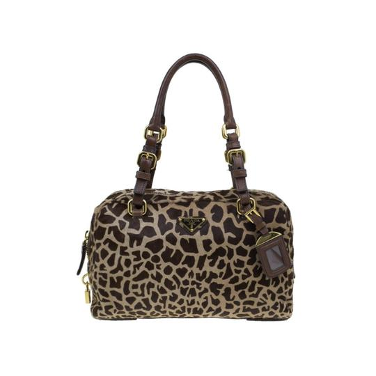 Preload https://item1.tradesy.com/images/prada-boston-animal-print-brown-fabric-leather-and-pony-hair-satchel-23330625-0-0.jpg?width=440&height=440