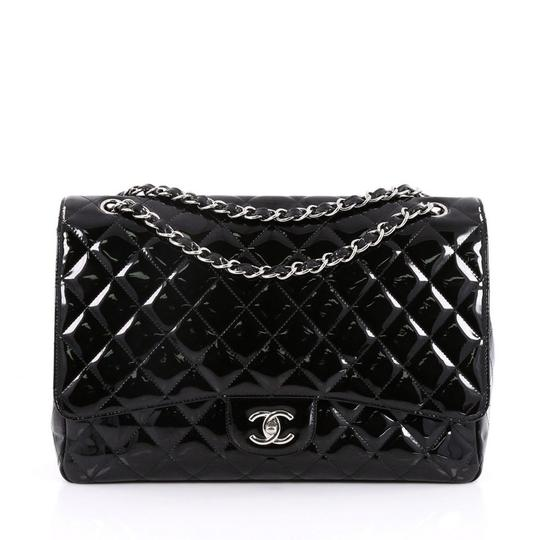 Preload https://item4.tradesy.com/images/chanel-classic-flap-classic-single-quilted-maxi-black-patent-leather-shoulder-bag-23331148-0-0.jpg?width=440&height=440