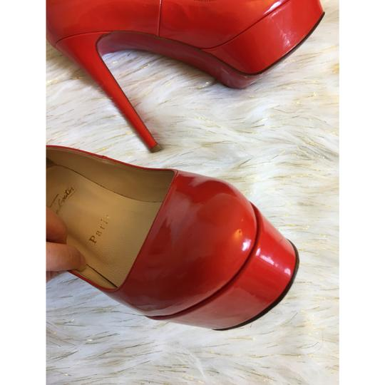 Christian Louboutin red-orange Platforms