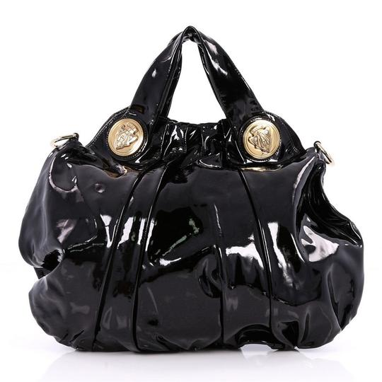 Preload https://item2.tradesy.com/images/gucci-hysteria-convertible-top-handle-large-black-patent-leather-shoulder-bag-23331181-0-0.jpg?width=440&height=440