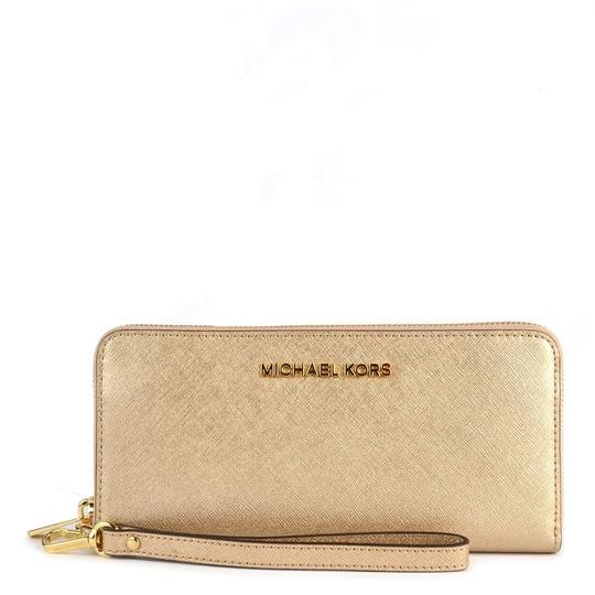 Preload https://item4.tradesy.com/images/michael-kors-gold-saffiano-leather-zip-around-large-travel-wristlet-wallet-23331273-0-0.jpg?width=440&height=440