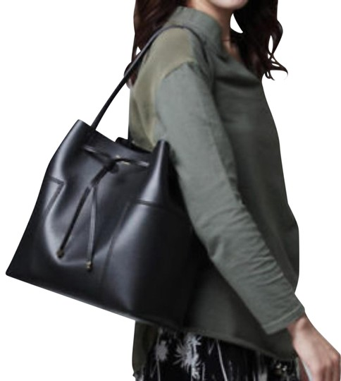 Preload https://item2.tradesy.com/images/tory-burch-t-block-t-nwot-drawstring-black-glazed-luxe-leather-tote-23331291-0-2.jpg?width=440&height=440
