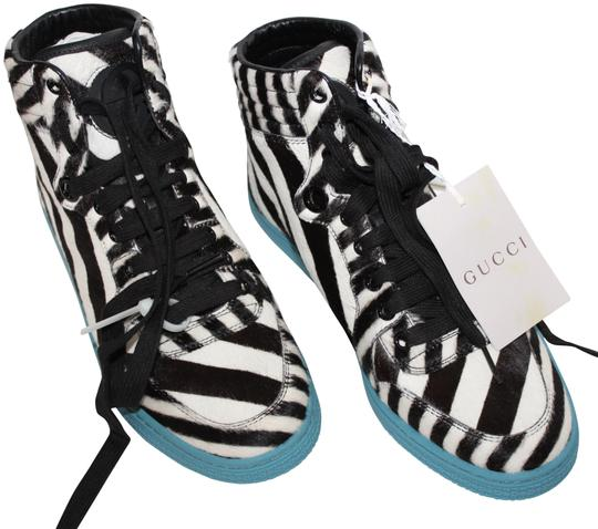 Preload https://item5.tradesy.com/images/gucci-women-s-pony-hair-striped-leather-hi-top-sneakers-sneakers-size-eu-375-approx-us-75-regular-m--23331349-0-1.jpg?width=440&height=440