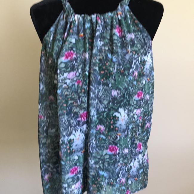 Preload https://item4.tradesy.com/images/green-floral-tank-topcami-size-14-l-23331478-0-0.jpg?width=400&height=650
