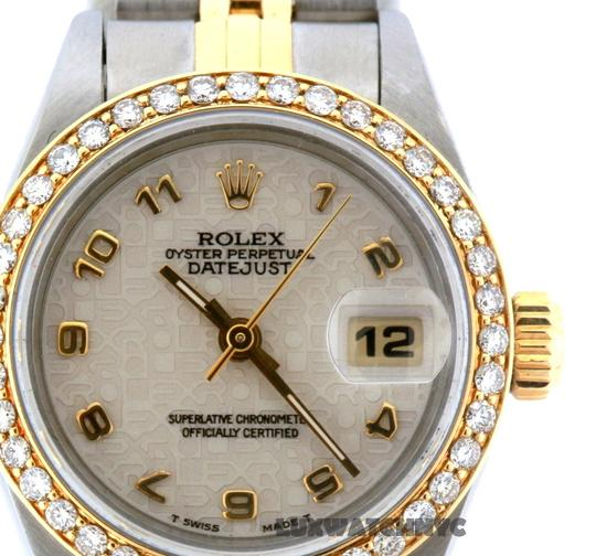 Preload https://item3.tradesy.com/images/rolex-1ct-26mm-ladies-datejust-with-box-and-appraisal-watch-23331627-0-0.jpg?width=440&height=440