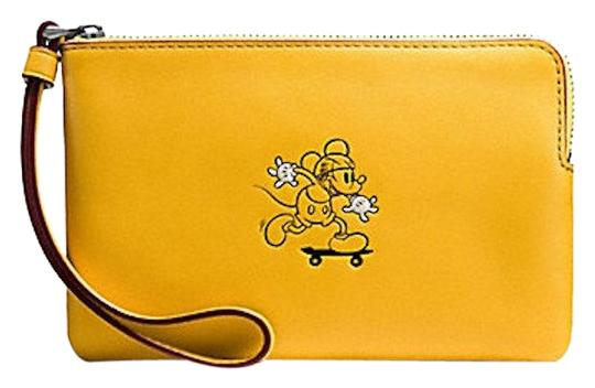 Preload https://item3.tradesy.com/images/coach-ltd-edition-corner-banana-leather-wristlet-23331797-0-1.jpg?width=440&height=440