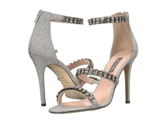 Preload https://item3.tradesy.com/images/sjp-by-sarah-jessica-parker-silver-orbit-embellished-stiletto-sandals-formal-shoes-size-eu-385-appro-23332332-0-0.jpg?width=440&height=440