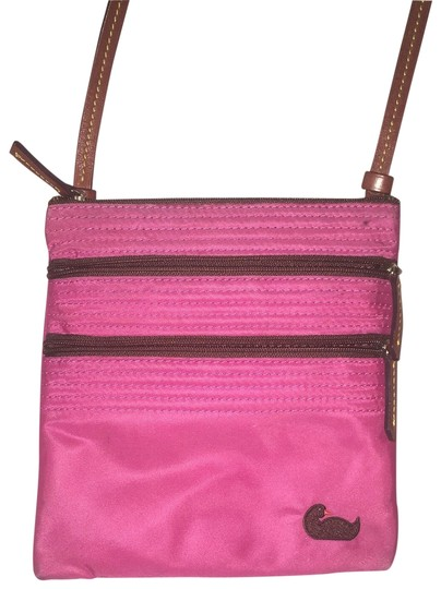 Preload https://item4.tradesy.com/images/dooney-and-bourke-northsouth-pink-nylon-leather-cross-body-bag-23332688-0-1.jpg?width=440&height=440