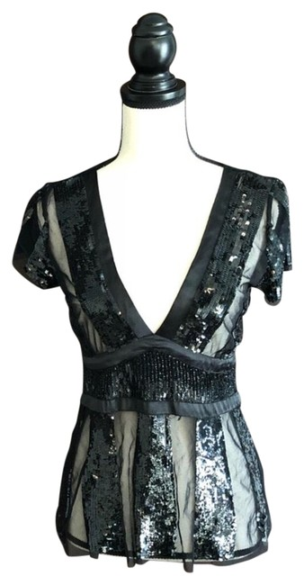 Preload https://item4.tradesy.com/images/black-sheer-sequins-night-out-top-size-4-s-23332718-0-1.jpg?width=400&height=650