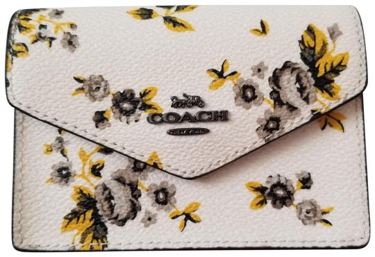 Preload https://item5.tradesy.com/images/coach-white-new-floral-envelope-key-fob-coin-purse-mini-card-case-wallet-23332899-0-1.jpg?width=440&height=440