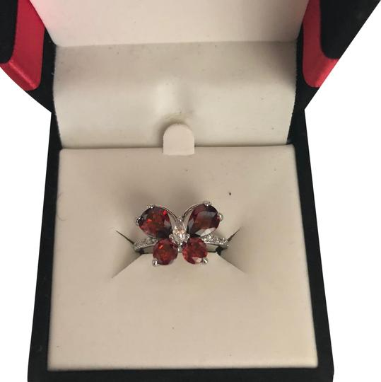 Preload https://item5.tradesy.com/images/red-and-silver-butterfly-ring-23333054-0-2.jpg?width=440&height=440