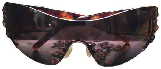Preload https://item2.tradesy.com/images/ed-hardy-brown-cocoa-sunglasses-23333346-0-1.jpg?width=440&height=440