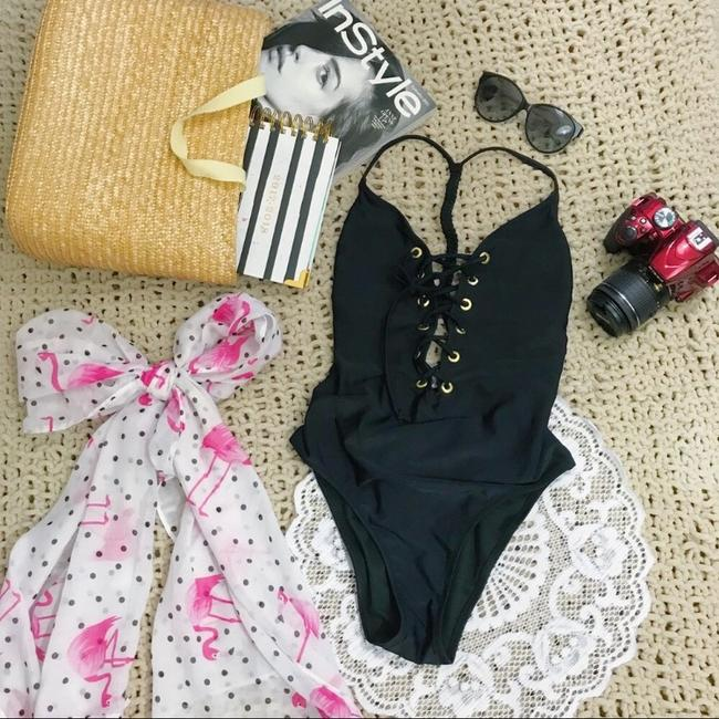 Preload https://item3.tradesy.com/images/abercrombie-and-fitch-black-exclusive-lace-one-piece-bathing-suit-size-4-s-23333487-0-0.jpg?width=400&height=650