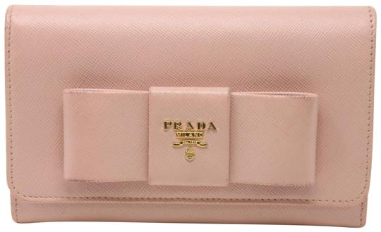 Preload https://item1.tradesy.com/images/prada-light-pink-saffiano-leather-bow-logo-leather-bifold-continental-wallet-23333950-0-1.jpg?width=440&height=440