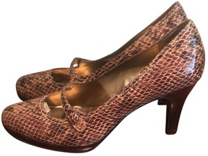 Anne Klein Natural, black, and brown Pumps