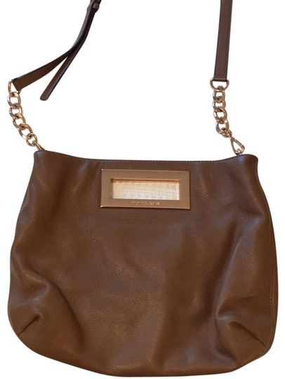 Preload https://item5.tradesy.com/images/michael-kors-with-removable-rose-gold-chain-tan-leather-cross-body-bag-23334409-0-1.jpg?width=440&height=440