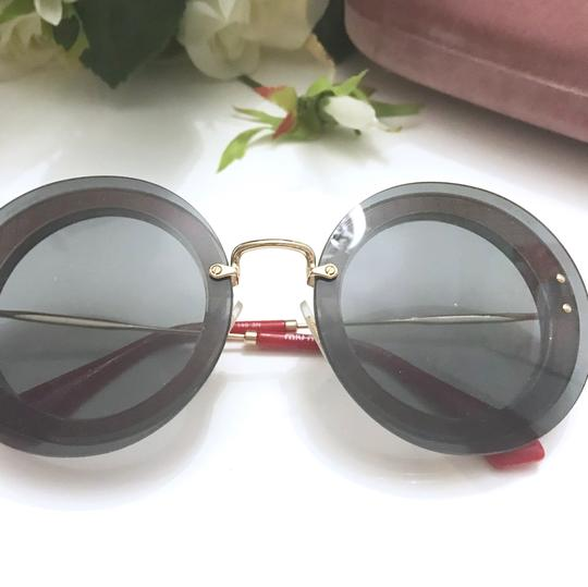 Miu Miu MIU MIU red round sunglasses