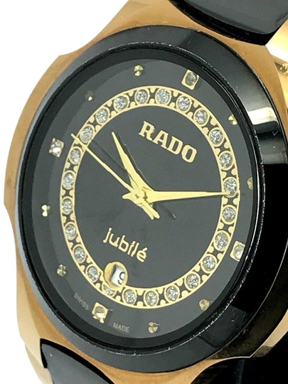 Preload https://item1.tradesy.com/images/rado-yellow-gold-and-black-jubile-tungsten-tone-stainless-steel-swiss-watch-23334945-0-1.jpg?width=440&height=440