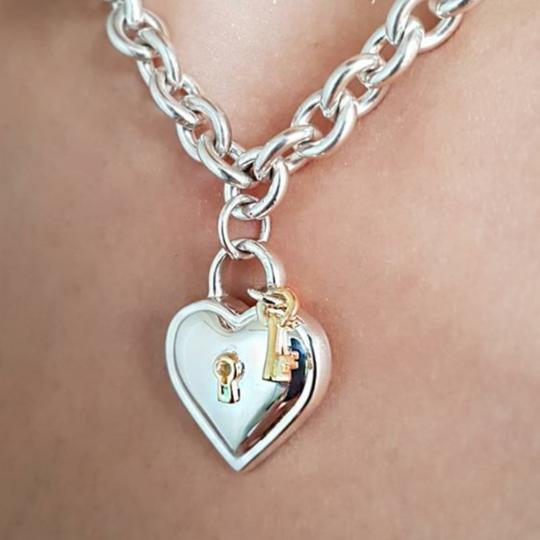 Preload https://item5.tradesy.com/images/tiffany-and-co-18ksilver-vintage-heart-lock-choker-necklace-23335064-0-1.jpg?width=440&height=440