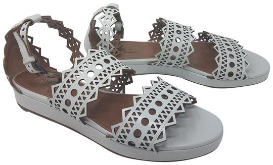 Preload https://item4.tradesy.com/images/alaia-white-beige-leather-laser-cut-ankle-strap-sandals-size-eu-385-approx-us-85-regular-m-b-23335103-0-2.jpg?width=440&height=440