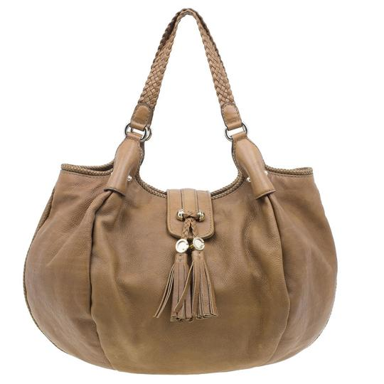 Preload https://item1.tradesy.com/images/gucci-marrakech-medium-tassels-metal-brown-leather-canvas-hobo-bag-23335140-0-0.jpg?width=440&height=440