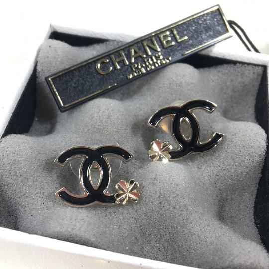 Chanel chanel black enamel flower studded earrings