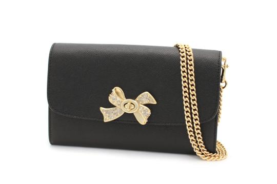 Preload https://item3.tradesy.com/images/coach-chain-with-bow-turnlock-f31480-black-gold-leather-cross-body-bag-23335947-0-0.jpg?width=440&height=440