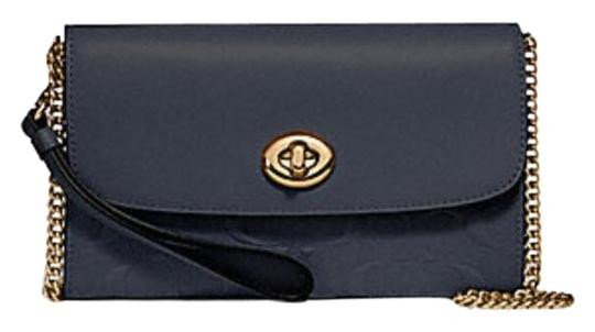 Preload https://item4.tradesy.com/images/coach-chain-in-signature-turnlock-f31480-blue-leather-cross-body-bag-23335973-0-1.jpg?width=440&height=440