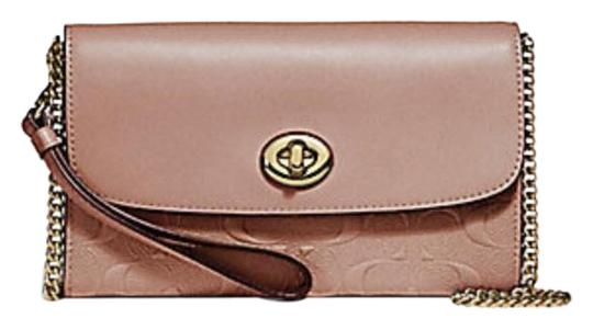 Preload https://item1.tradesy.com/images/coach-chain-in-signature-turnlock-f31480-beige-leather-cross-body-bag-23335975-0-1.jpg?width=440&height=440