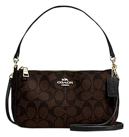 Preload https://item1.tradesy.com/images/coach-top-handle-pouch-in-pebble-style-f36645-signature-brown-leather-cross-body-bag-23336060-0-2.jpg?width=440&height=440