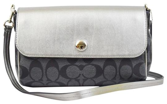 Preload https://item5.tradesy.com/images/coach-ruby-revesible-in-signature-59534-black-silver-printed-coated-canvas-cross-body-bag-23336134-0-2.jpg?width=440&height=440